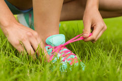 Fit woman tying her shoelace Royalty Free Stock Images