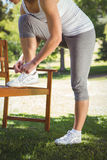 Fit woman tying her shoelace Royalty Free Stock Photo