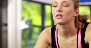 Fit woman using exercise bike stock video