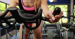 Fit woman using exercise bike stock video footage