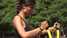 Fit Woman Using Exercise Machine. Stock video in 4k or HD resolution stock footage