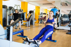 Fit woman using the rowing machine Stock Image