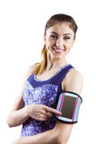 Fit woman using smartphone in armband Royalty Free Stock Photo