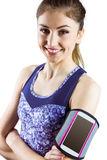 Fit woman using smartphone in armband Royalty Free Stock Photos