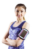 Fit woman using smartphone in armband Royalty Free Stock Image