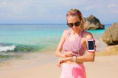Woman using smartwatch during workout Royalty Free Stock Images