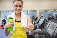 Fit woman using the treadmill Stock Photos
