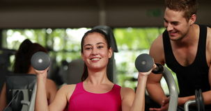 Fit woman using weight machine stock footage