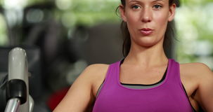 Fit woman using weight machine stock video footage