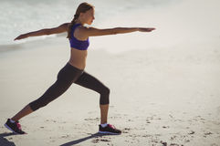 Fit woman warming up on beach Royalty Free Stock Photography