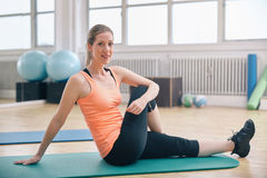 Fit woman warming up at gym Stock Photos