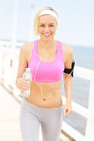 Fit woman with water Royalty Free Stock Photos
