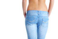 Fit woman wearing blue  jeans Royalty Free Stock Images