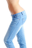 Fit woman wearing blue  jeans Stock Photo