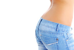 Fit woman wearing blue  jeans Royalty Free Stock Photography