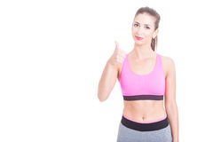 Fit woman wearing fitness clothes showing thumb up Stock Photo