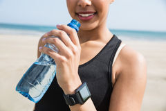 Fit woman wearing smart watch Royalty Free Stock Images