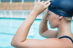 Fit woman wearing swimming goggle in pool Royalty Free Stock Images