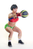 Fit woman on a white background holding a gym ball Royalty Free Stock Photo