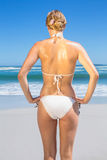 Fit woman in white bikini on the beach rear view Stock Photo