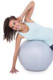 Fit woman wokring out on exercise ball Royalty Free Stock Photography