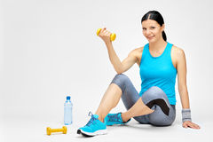 Fit woman woman training with dumbbell at the gym. Fitness studio concept Royalty Free Stock Photos