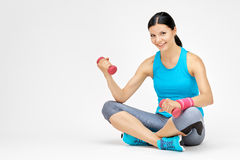 Fit woman woman training with dumbbell at the gym Stock Photo