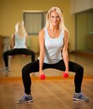 Fit woman work out in gym making squat Royalty Free Stock Photo