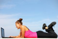Fit woman working on computer Stock Photos