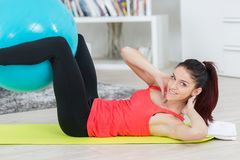 Fit woman working out with ball royalty free stock photo