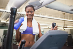 Fit woman working out on the cross trainer Stock Photo