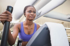 Fit woman working out on the cross trainer Royalty Free Stock Images