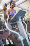 Fit woman working out on the cross trainer Stock Photography
