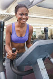 Fit woman working out on the cross trainer Royalty Free Stock Photos