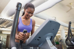 Fit woman working out on the cross trainer Stock Image