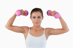 Fit woman working out with dumbbells Stock Images