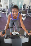 Fit woman working out on the exercise bike Stock Photography