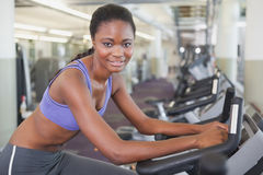 Fit woman working out on the exercise bike Royalty Free Stock Images