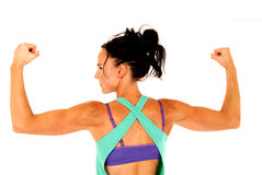 Fit woman working out flexing arm muscles from behind Royalty Free Stock Images