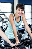 Fit woman working out at spinning class Stock Image