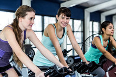 Fit woman working out at spinning class Stock Images