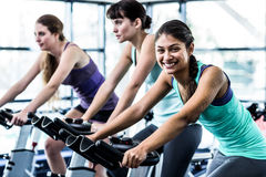 Fit woman working out at spinning class Royalty Free Stock Photos