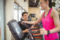 Fit woman working out with trainer Stock Photos