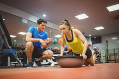 Fit woman working out with trainer Royalty Free Stock Photo