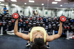 Fit woman working out in weights room Royalty Free Stock Image