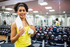 Fit woman working out in weights room Royalty Free Stock Photos