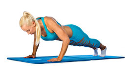Fit woman working on push up Royalty Free Stock Photos