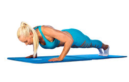 Fit woman working on push up Royalty Free Stock Photo