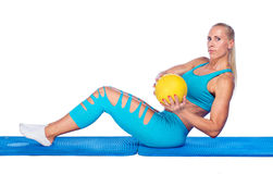 Fit woman working on sit ups exercise Royalty Free Stock Images