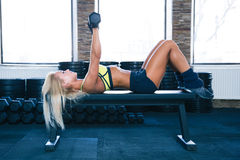 Fit woman workout with dumbbells Royalty Free Stock Photos